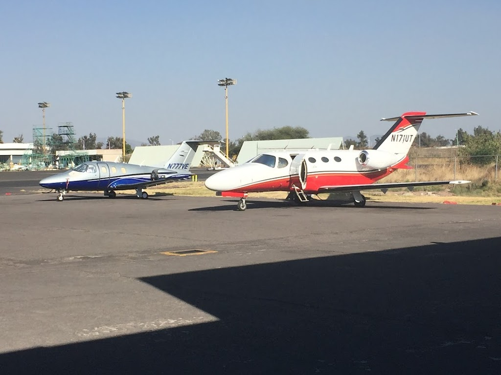 planes standing in private airport
