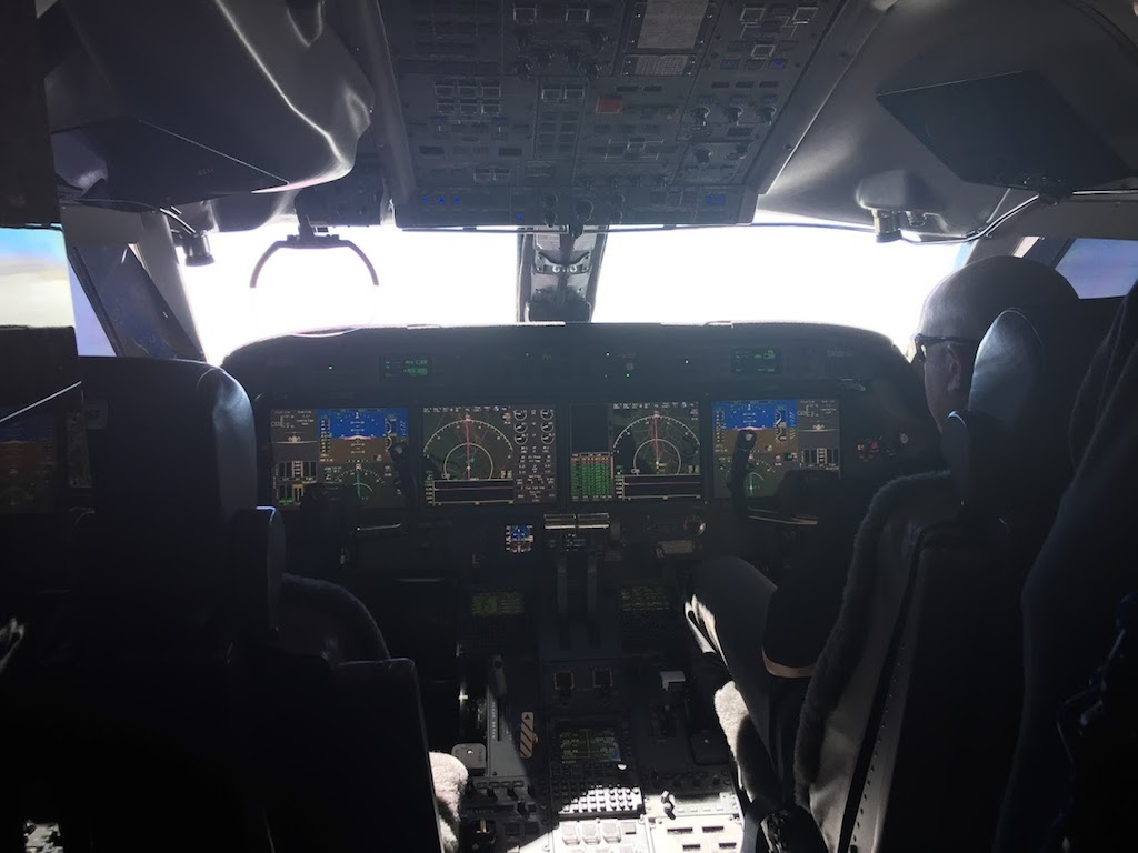 cock pit of private jet, photo by Diana Bruk