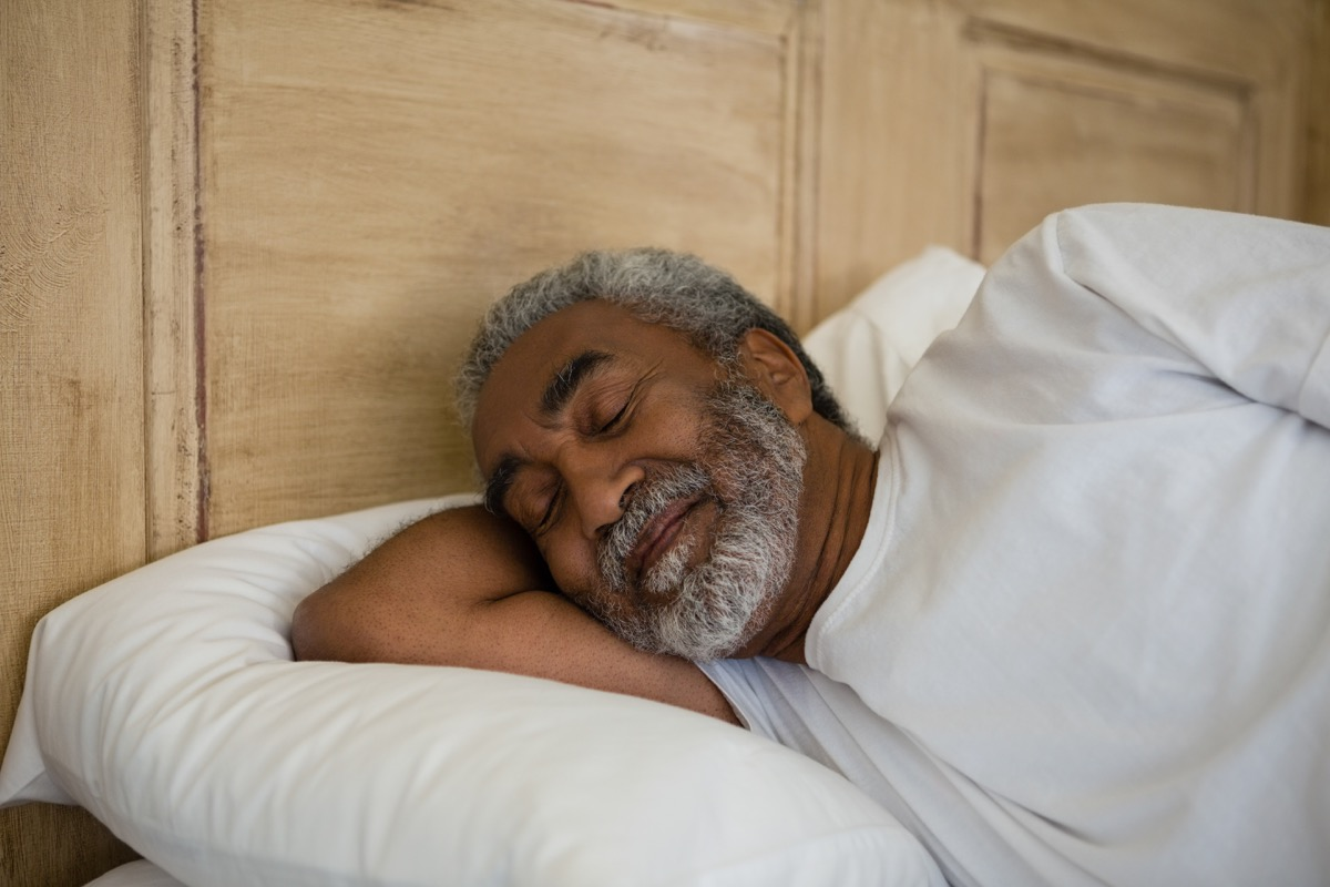 Senior black man sleeping well