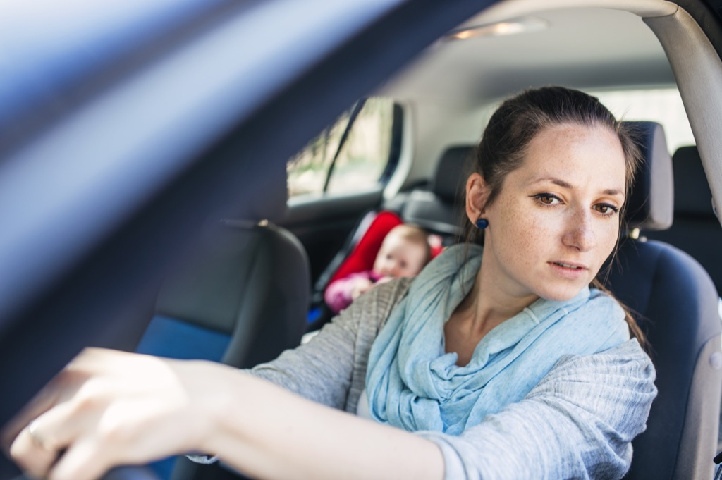 young woman driving Moms Should Never Say Fake American Traditions