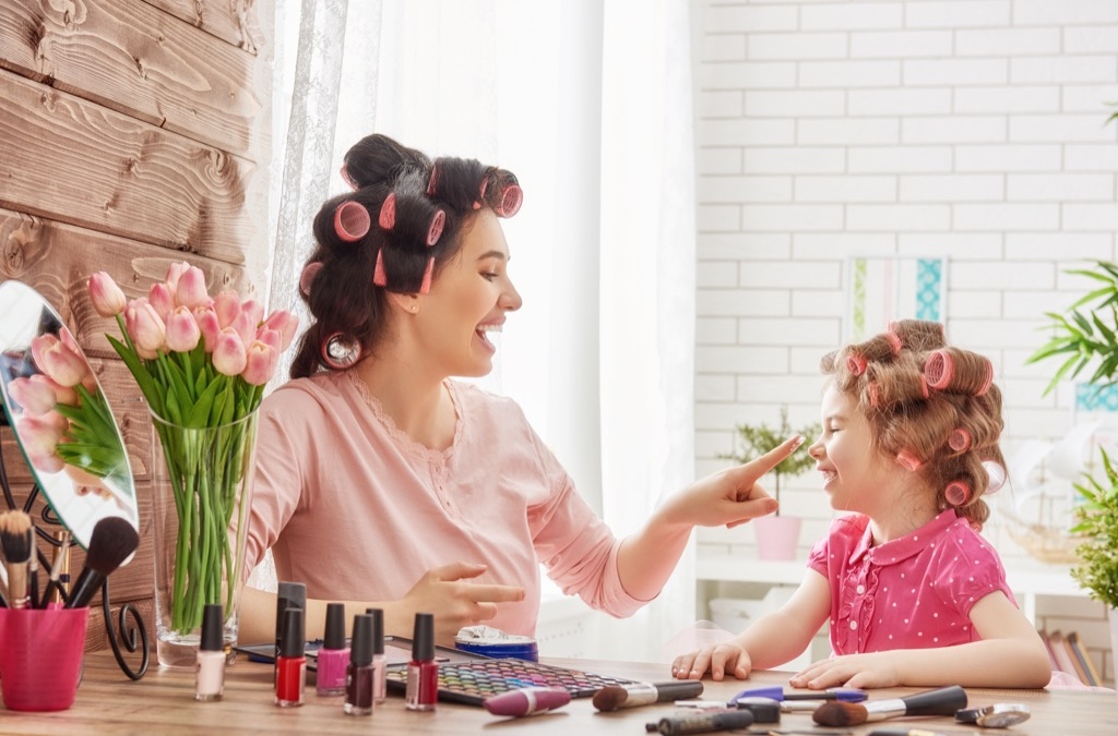 mom and daughter doing hair Moms Should Never Say