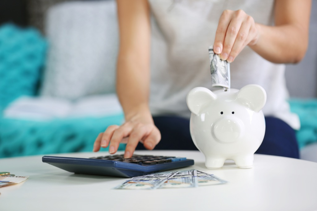 putting money into piggy bank, stay at home mom