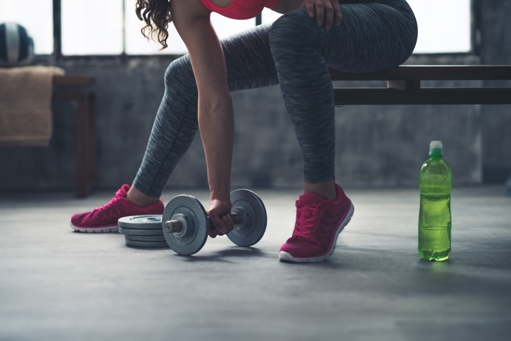 Woman lifting dumbbell Exercises for Adding Muscle