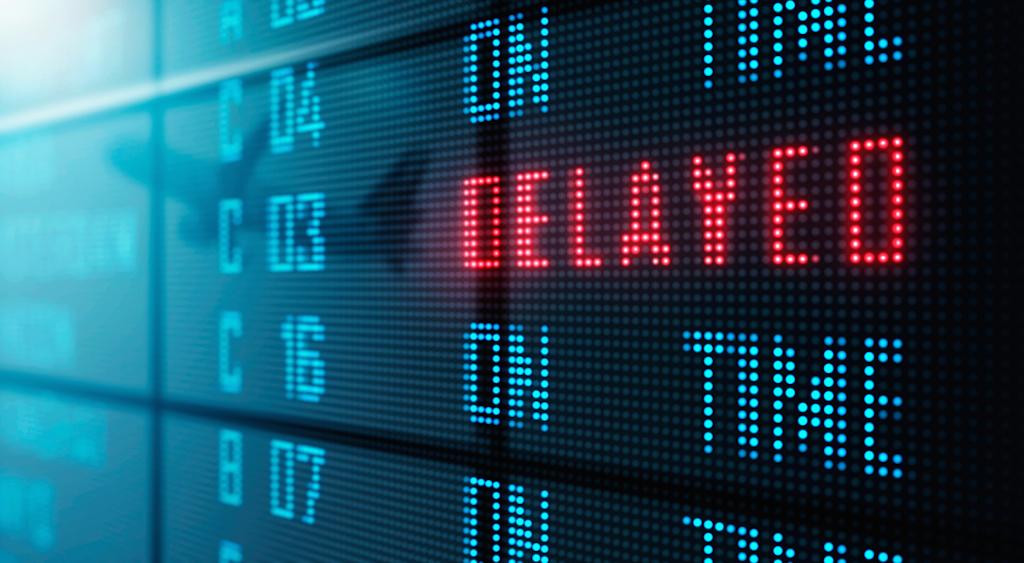 airport board shows flight delay