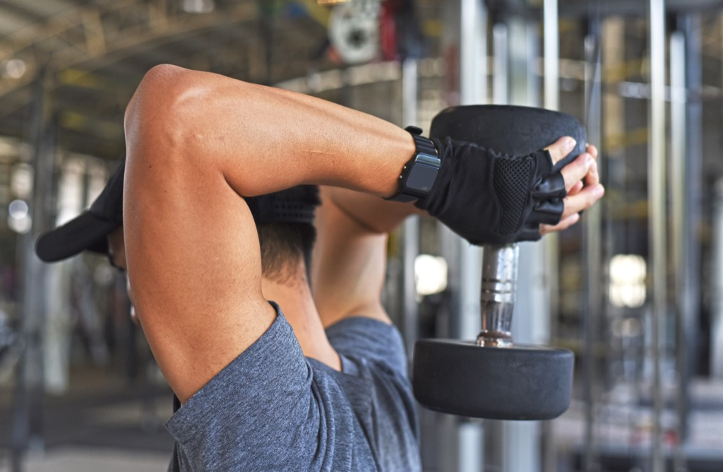 Seated overhead dumbbell extension Exercises for Adding Muscle