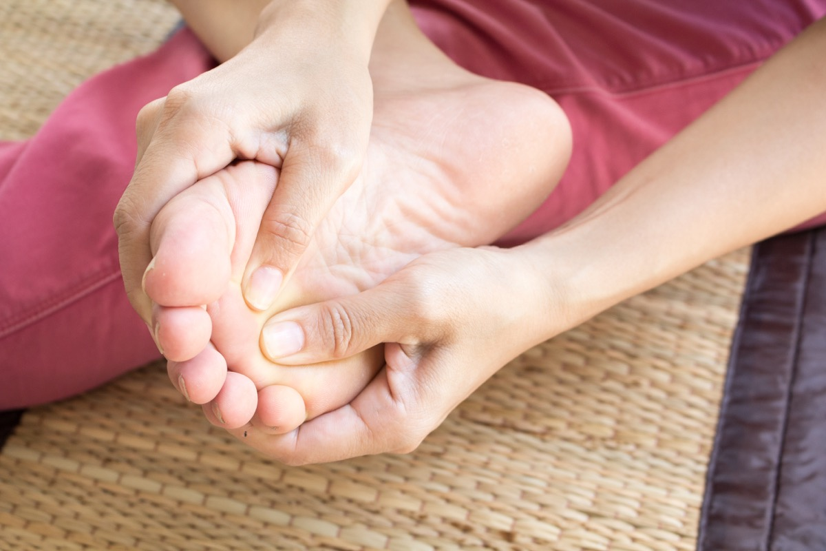 Woman checking her foot for any issues