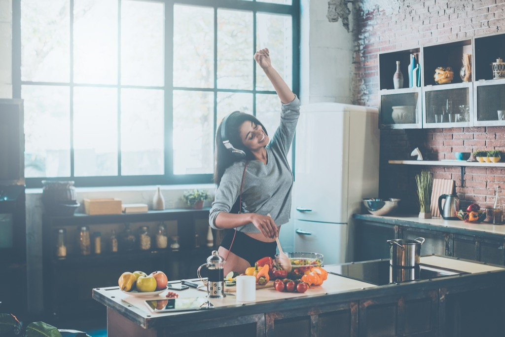 woman dancing while eating funny things people do