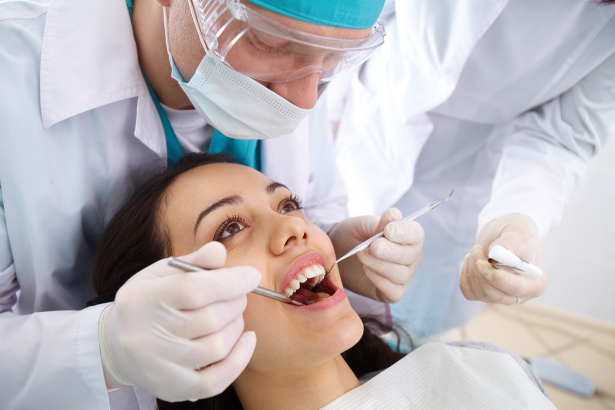 Woman getting her teeth looked at at the dentist's office