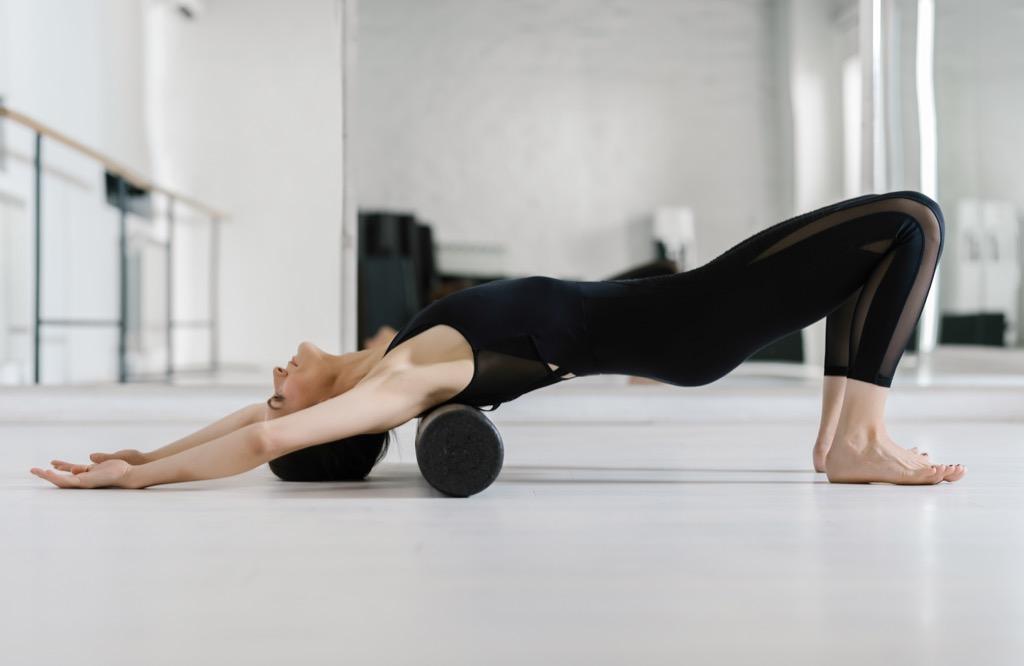woman pilates reformer roller 500 calorie workouts