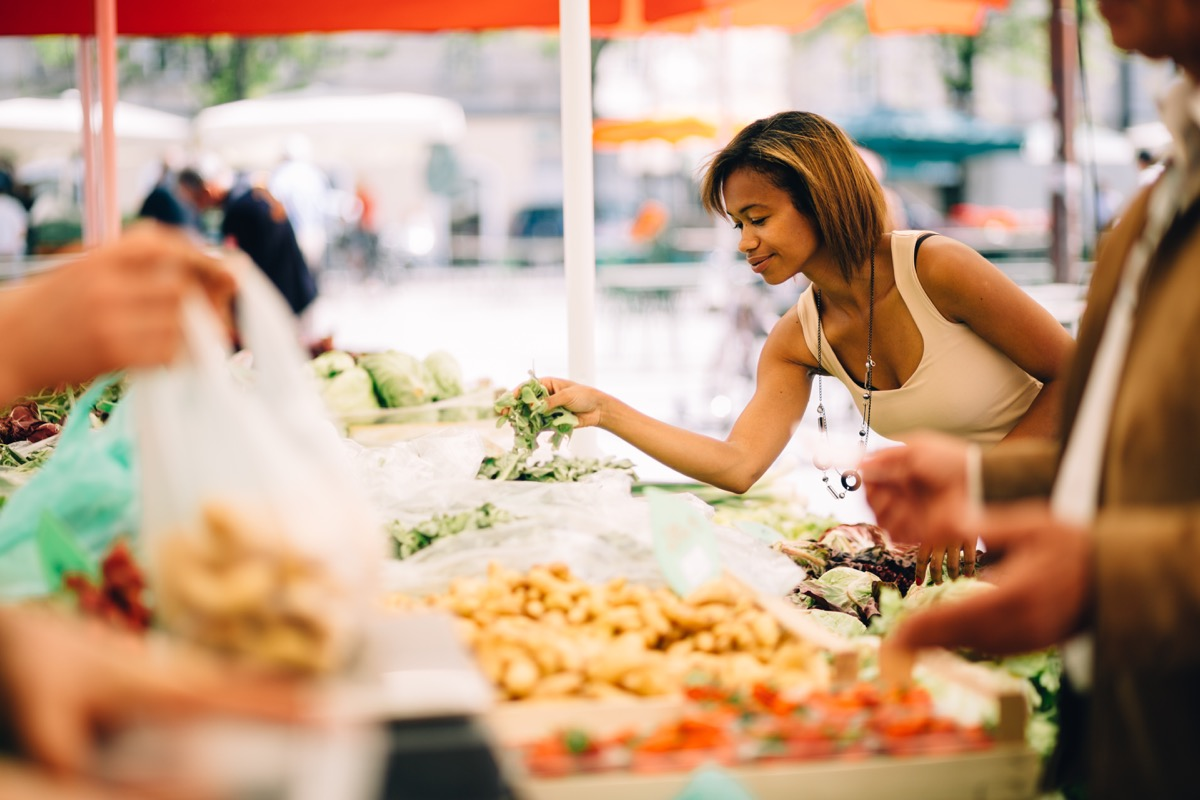 Black woman shopping for vegetables at the farmer's market