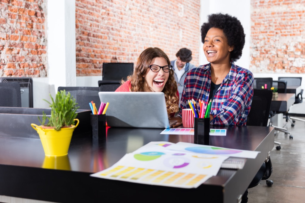 women laughing at work crazy health benefits of laughter