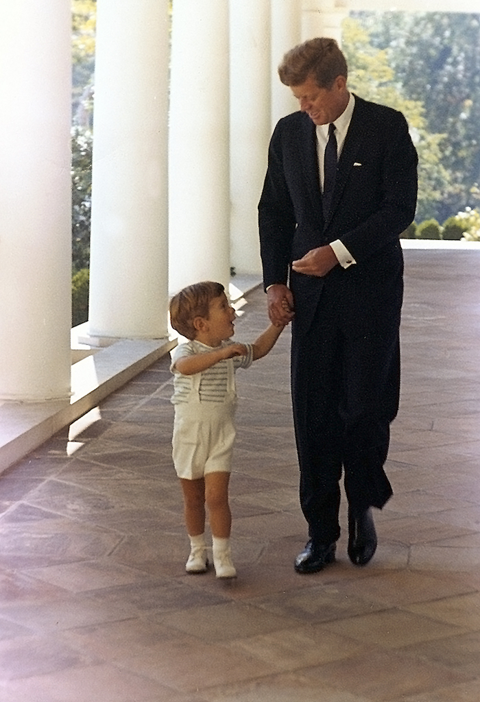 John F Kennedy Jr with Father Kennedys