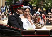 The Duke and Duchess of Sussex, Meghan Markle and HRH Prince Harry (of Wales) give a wave to the crowd after their wedding