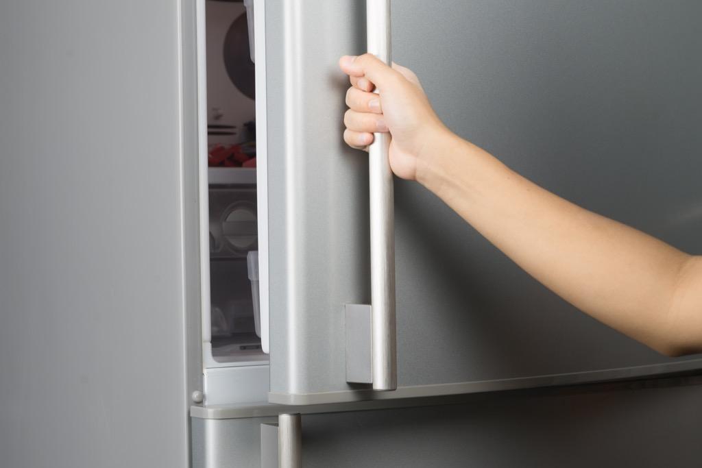 Woman opening freezer clothing hacks