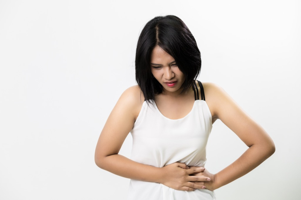 Woman with Cramps Hair Thinning