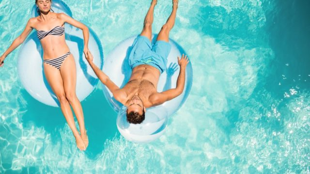 couple in pool worst home improvements