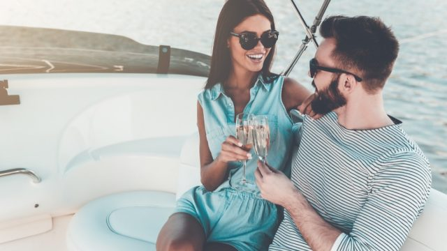 wealthy couple on a boat