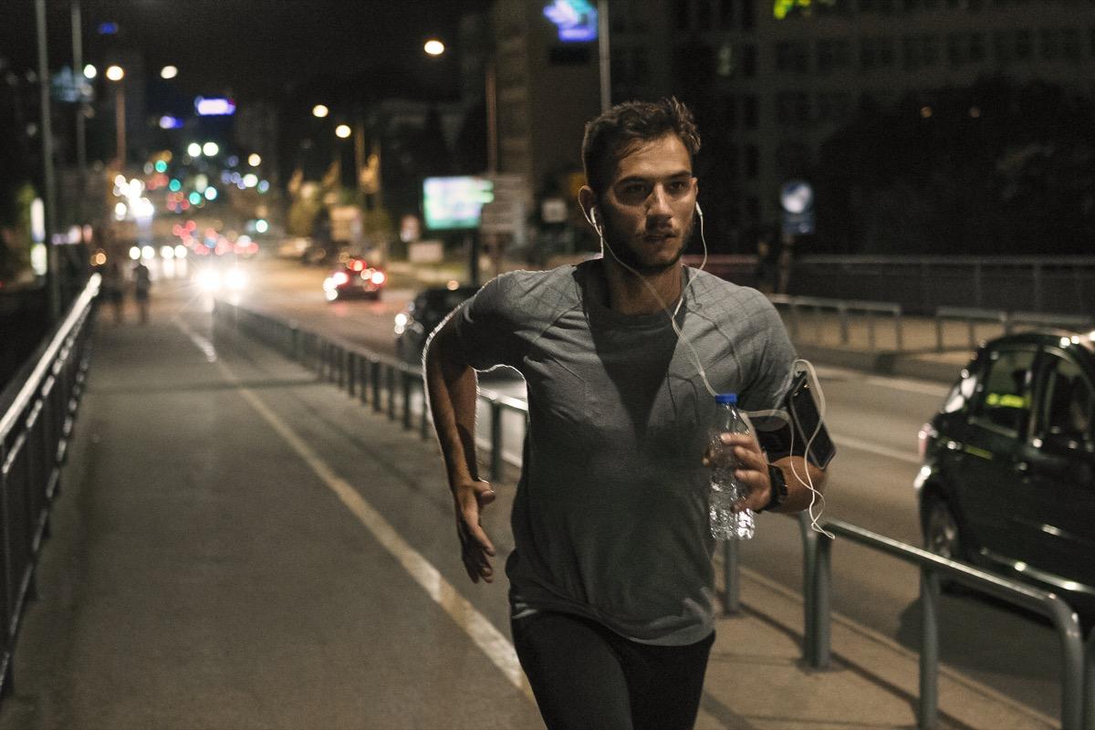 Young man running at night