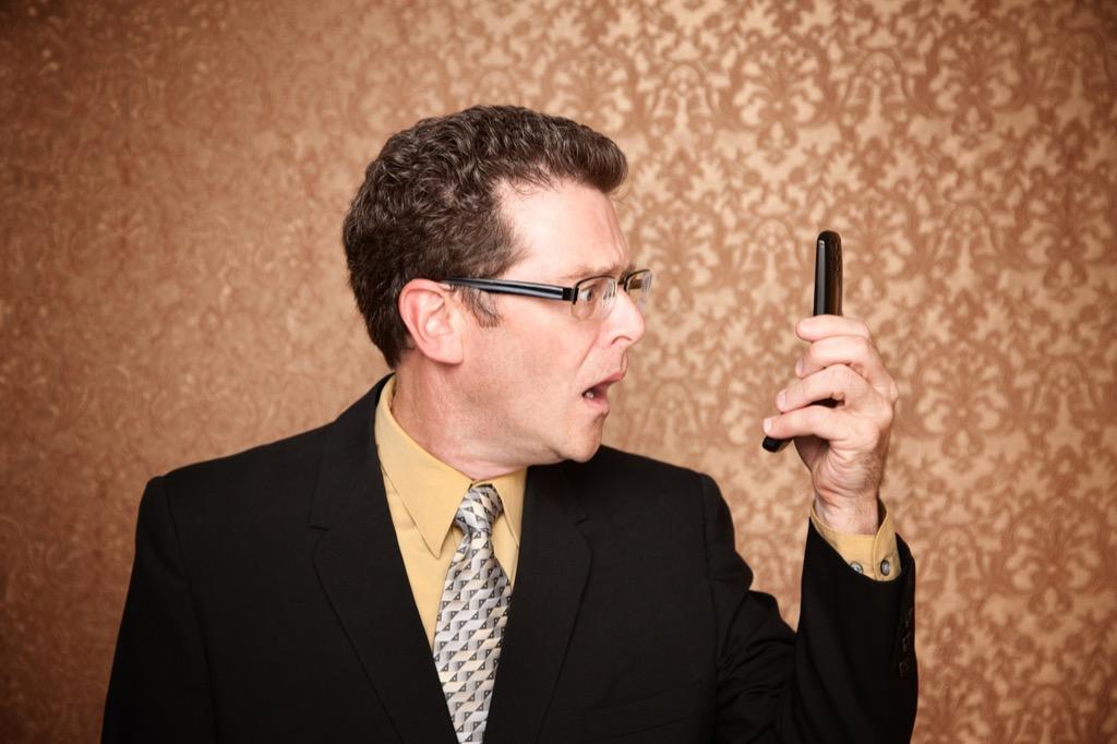 man on phone shock surprise