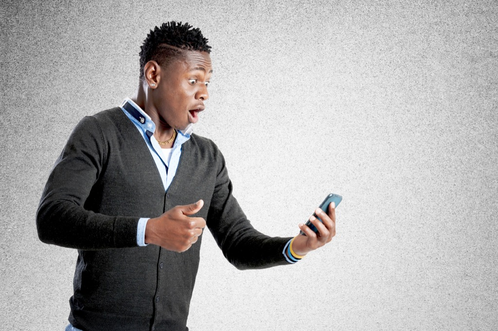 man on his cellphone shocked stunned