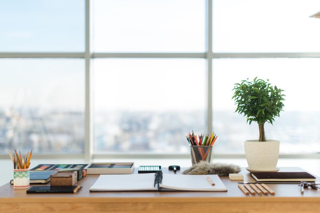 organized desk overlooking east river