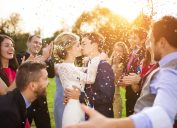 bride kissing groom at an outdoor wedding