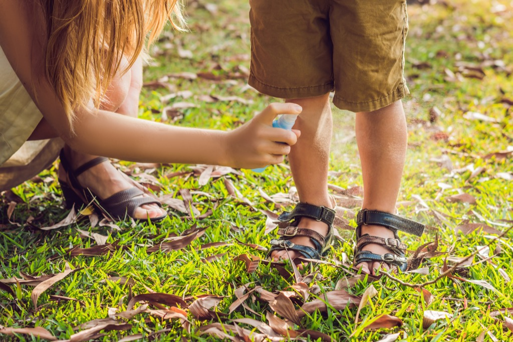 woman spraying bug spray on son, top slang words in every state