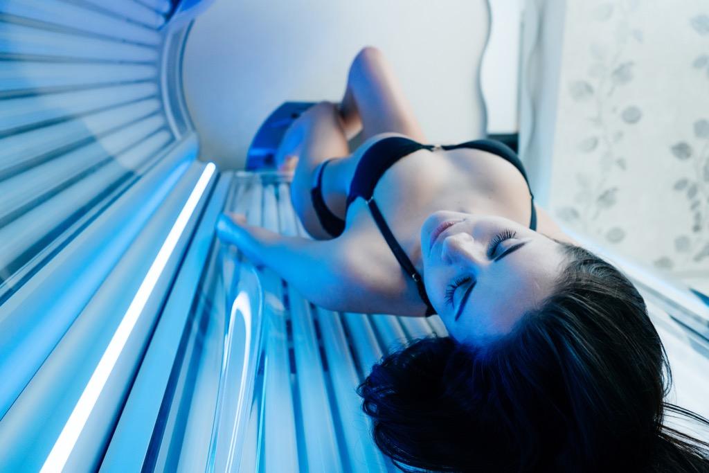 girl in tanning bed Skin Cancer Risks