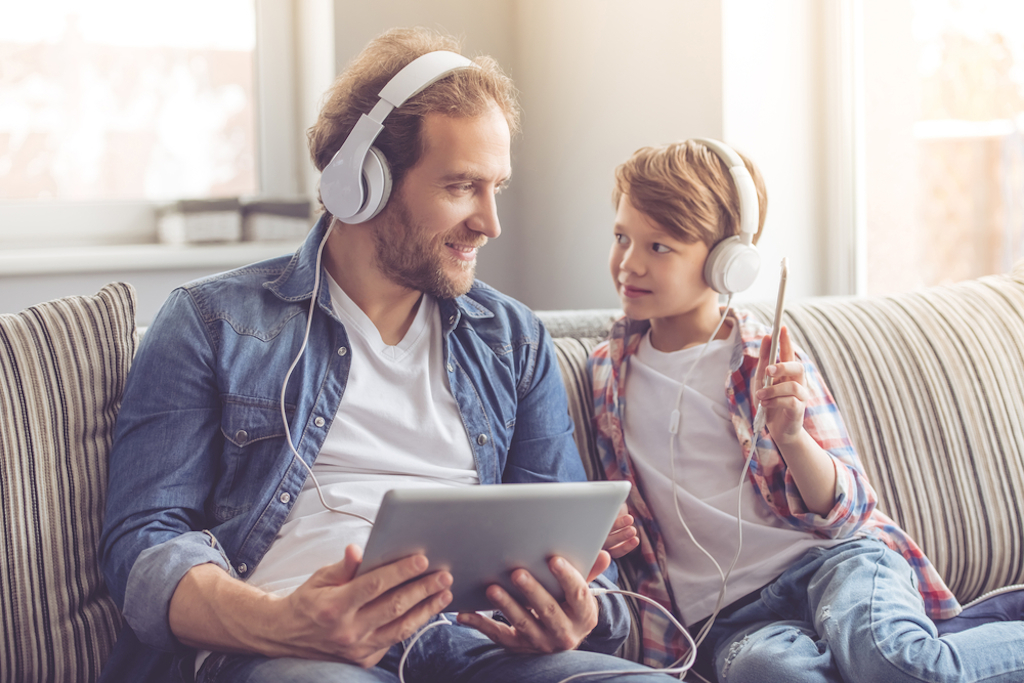 father and son listen to music together