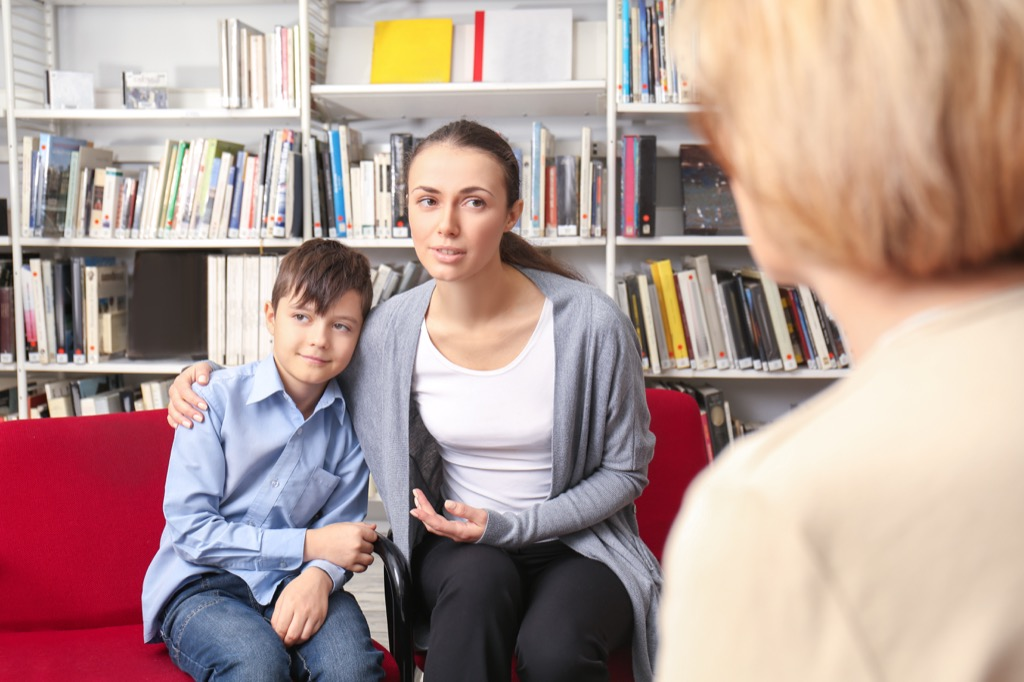 mother and son at a parent-teacher conference, things you should never say to a teacher