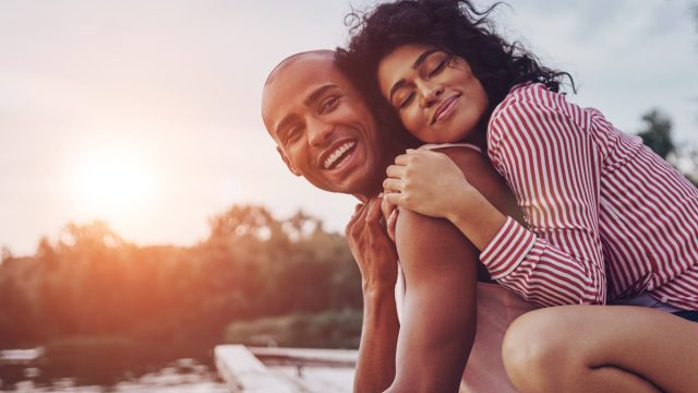 two happy people on the beach, happiness hacks