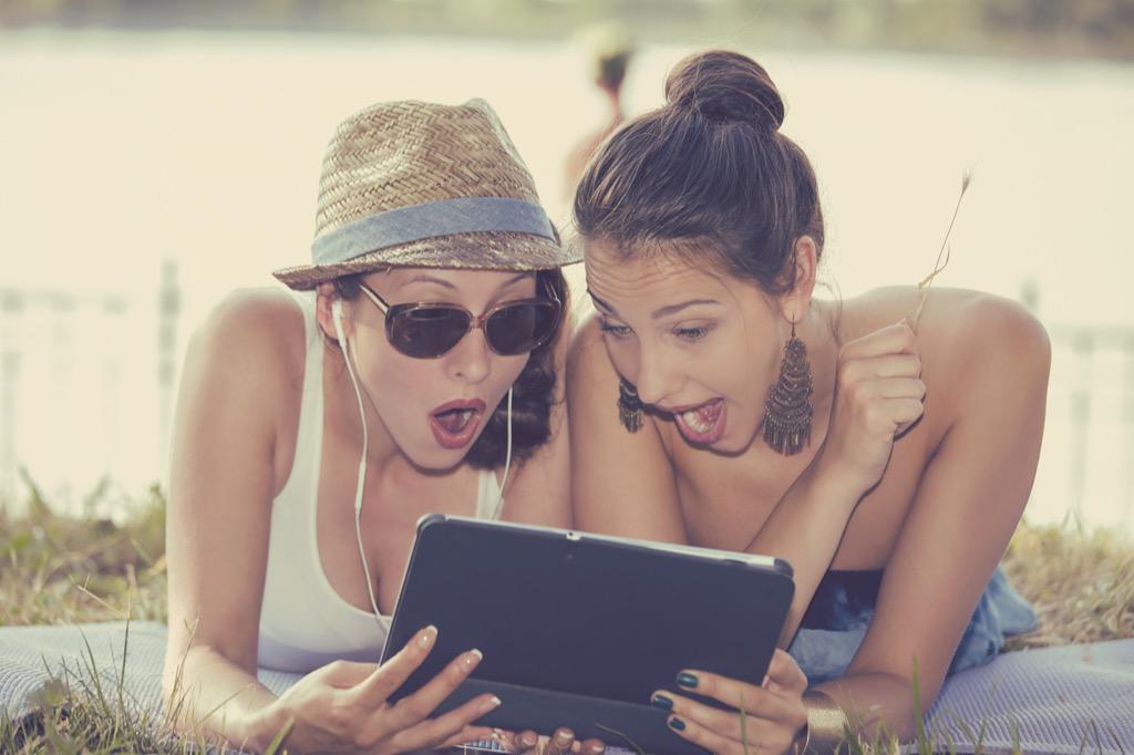women looking shocked at ipad