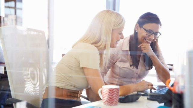 woman mentoring coworker