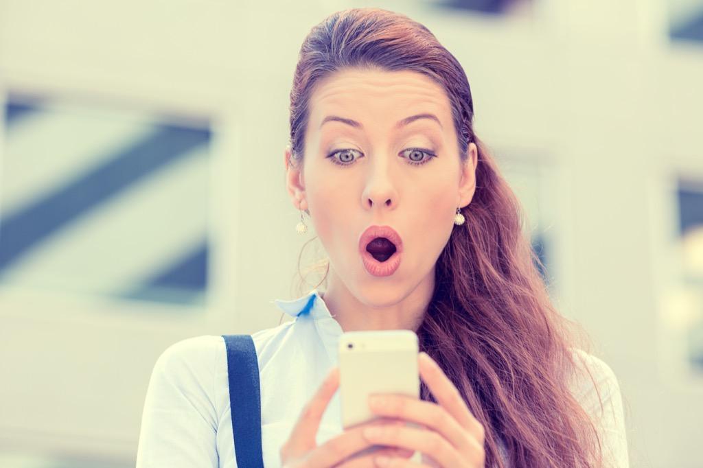 woman surprised on her phone {Brain Games}