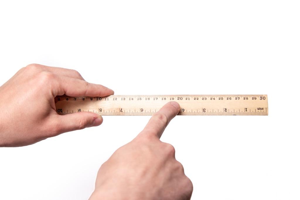 Man holding ruler, hard math problems