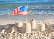 american flag in sand castle on beach facts about the oceans
