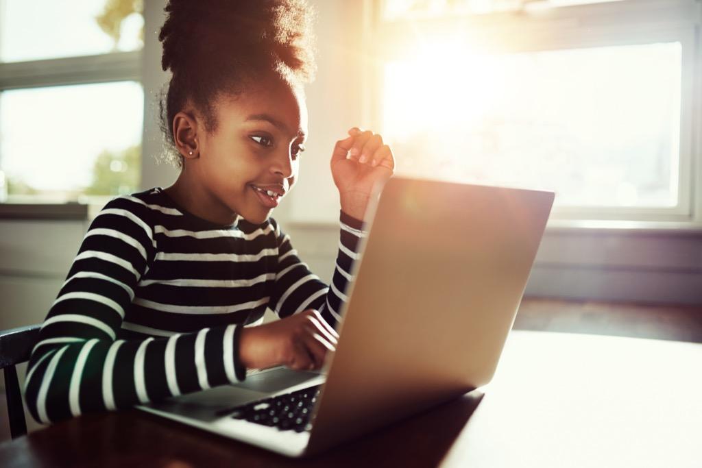 kid on computer doing homework