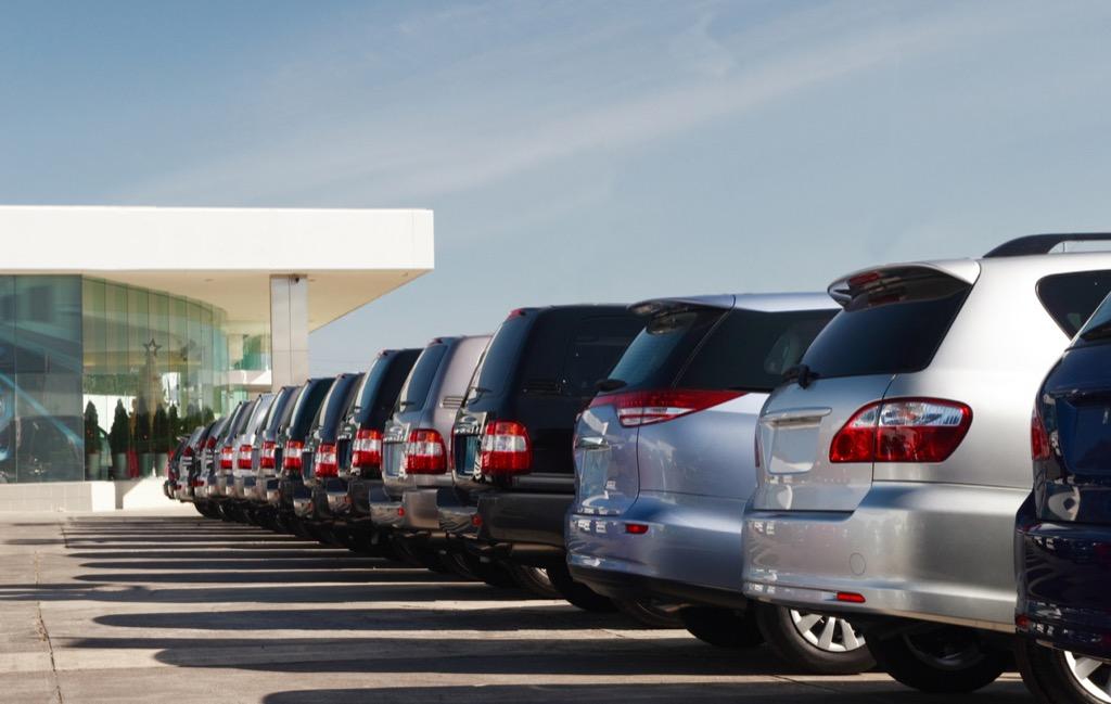 rows of suvs at car dealership