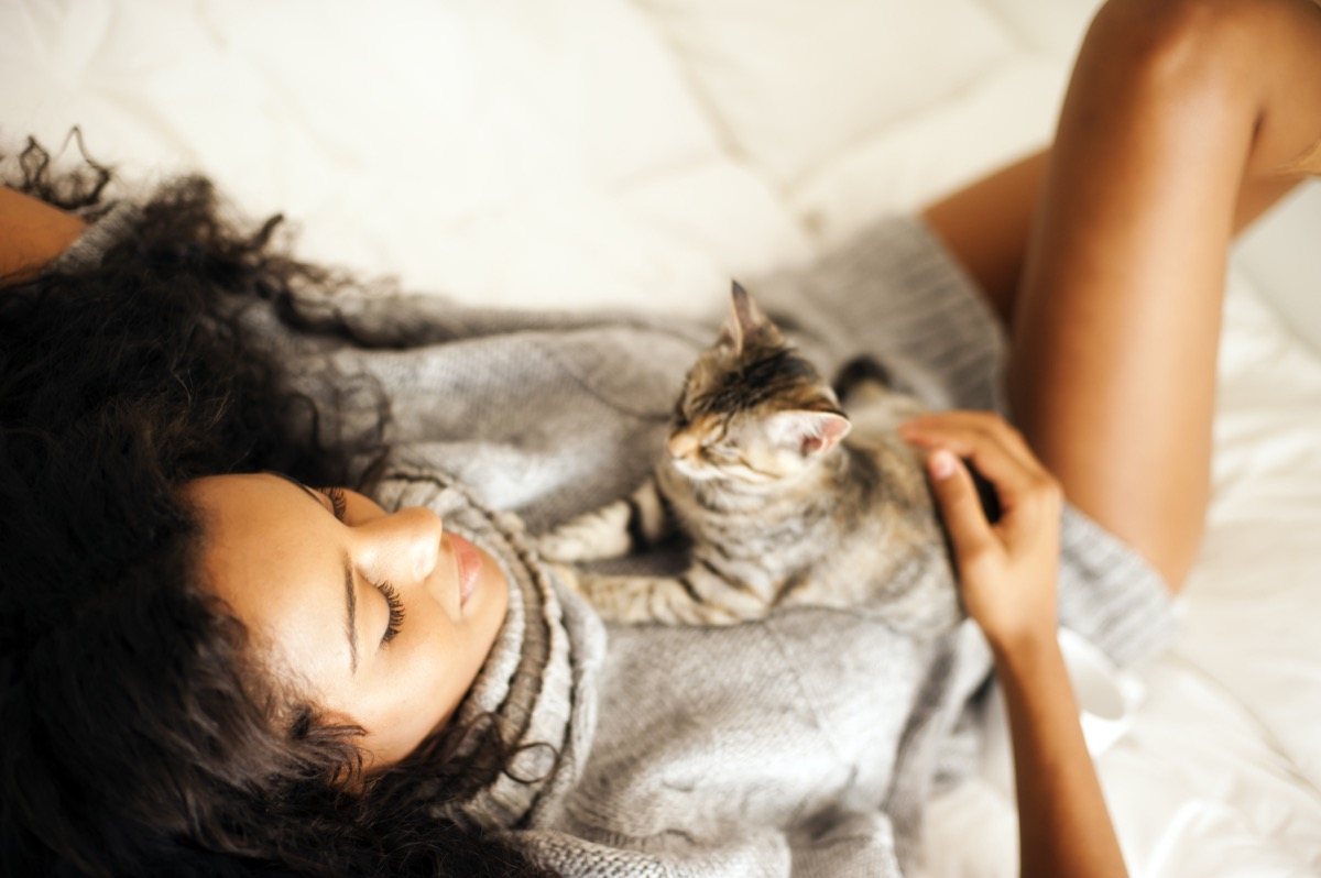 cat owner cuddling their cat