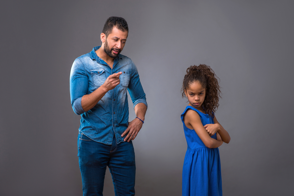 father arguing with daughter