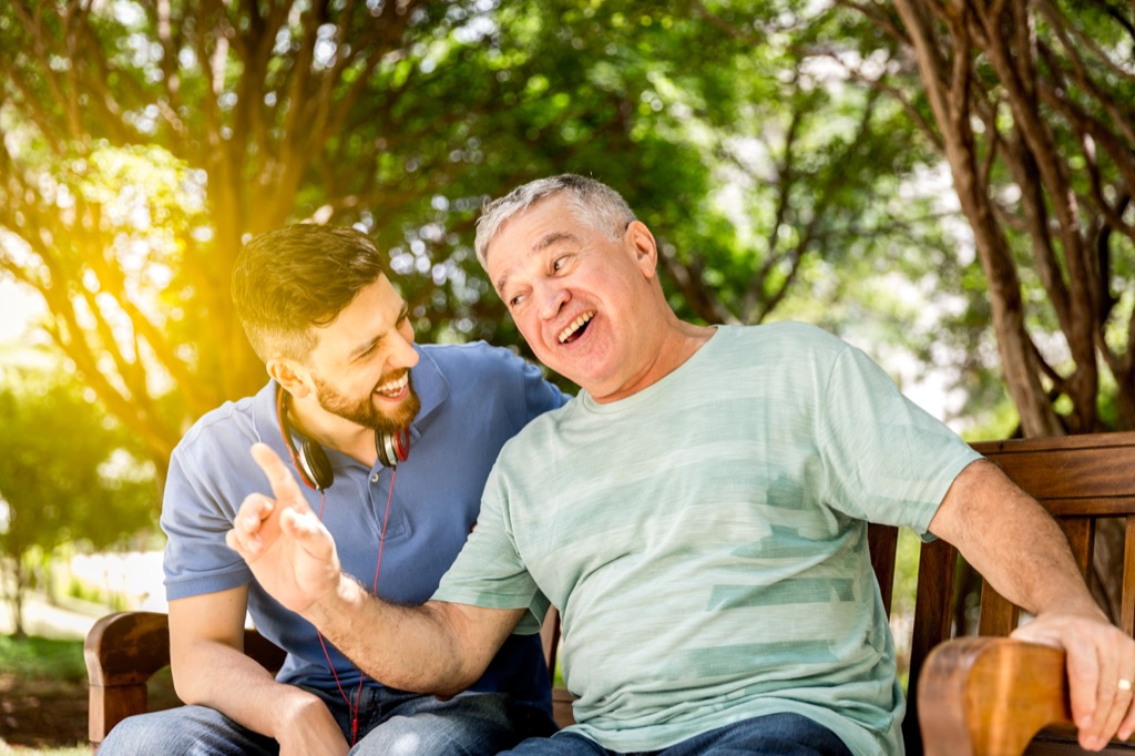 dad and son laughing on a park bench, dad jokes