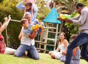 families playing with waterguns at park 20 surprising ways fatherhood changes you