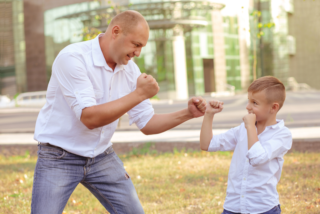 Dad Teaching Son How to Fight