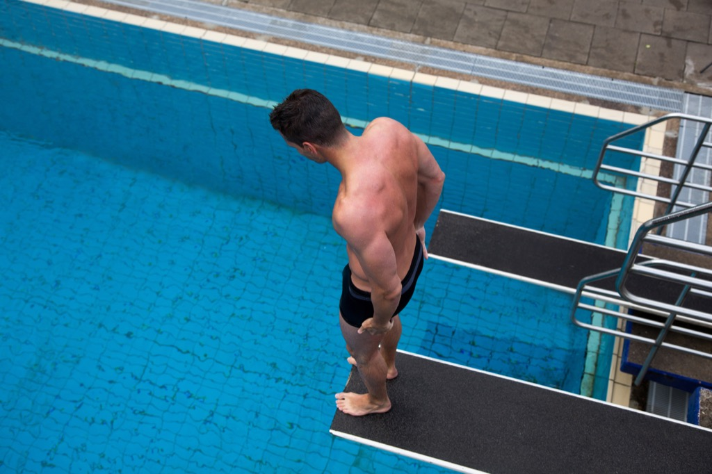Man with a fear of heights on the diving board