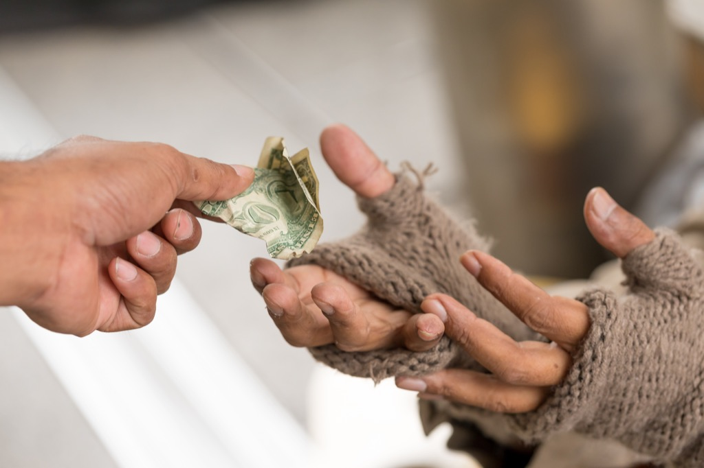 handing dollar to poor person, facts about the lottery