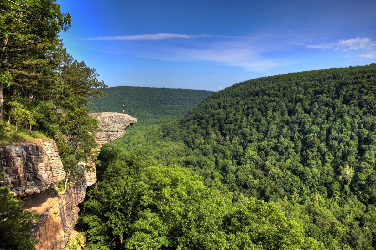 crag juts out among trees in arkansas