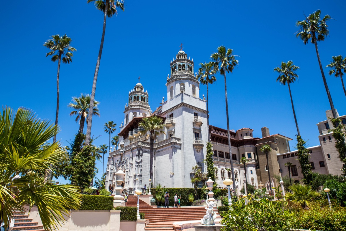 hearst castle with palm trees