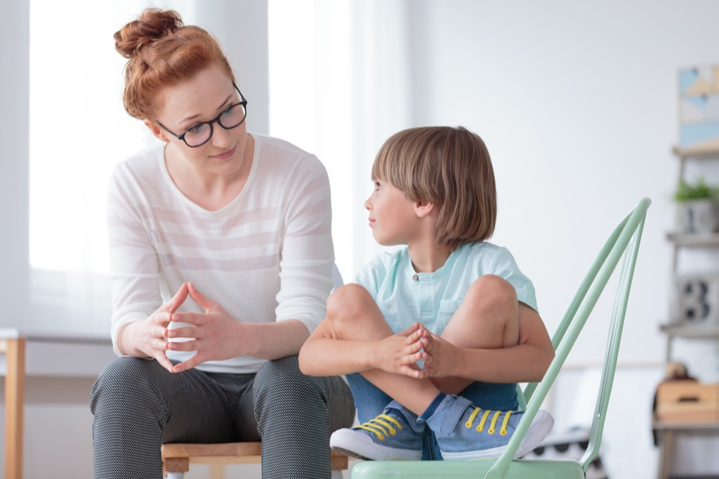 woman talking to young boy, parent divorce