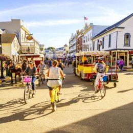 people enjoying the summer on Mackiniac island main street