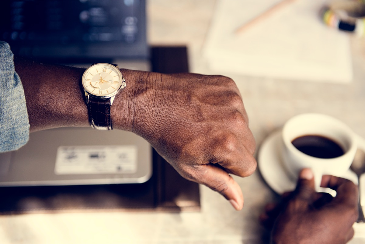 man checking watch when someone is late